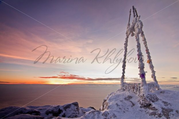Frozen triangular sign in the mountains against the sea – Stock photos from around the world