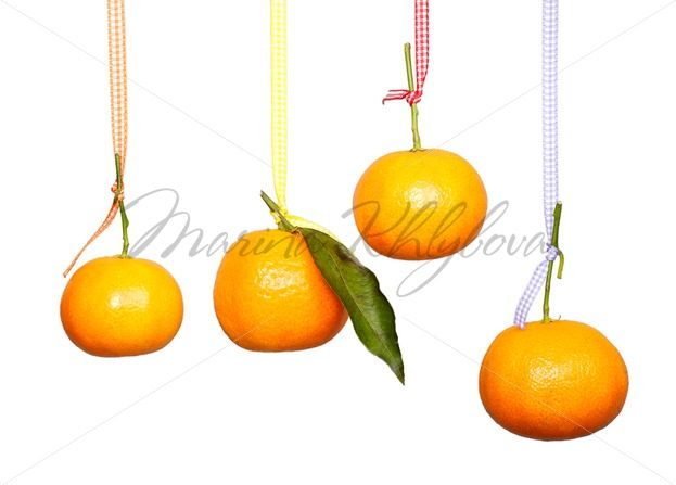 Mandarins are hanging on the colored tape – Stock photos from around the world