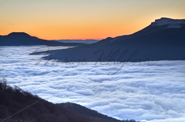 Sea of clouds in the mountains at the sunset – Stock photos from around the world
