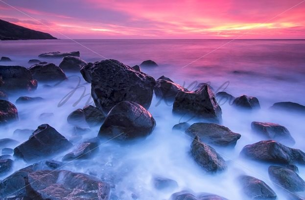 Stones in the sea at the sunset – Stock photos from around the world