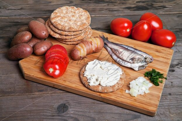 Swedish herring and ingredients on the cutting board – Stock photos from around the world