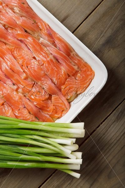 The dish for baking with thin slices of salmon – Stock photos from around the world