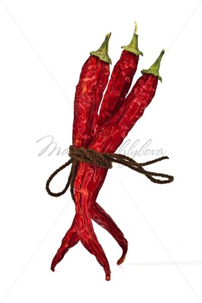 Three red chili peppers tied by rope – Stock photos from around the world