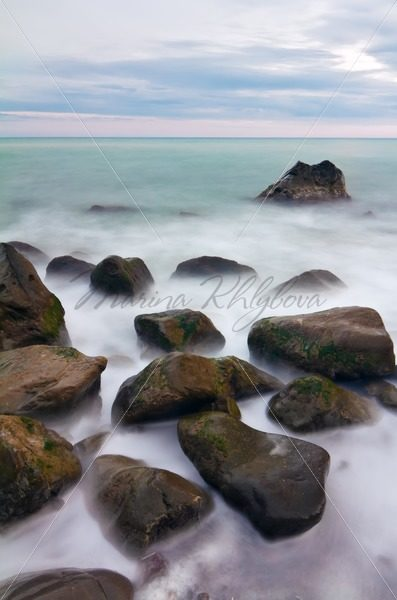 Wet stones on the sea at the sunrise – Stock photos from around the world