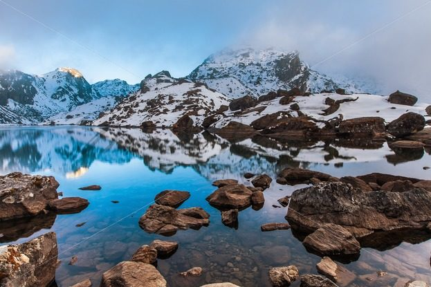 Beautiful blue mountain Gosainkund lake at the sunset – Stock photos from around the world