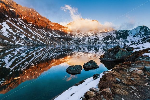 Beautiful mountain lake at the sunset in Himalayas – Stock photos from around the world