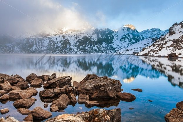 Himalayas reflected in the Hindu holy Gosain Kunda lake – Stock photos from around the world