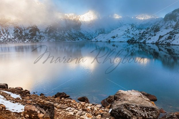 Mountains around lake at the sunset – Stock photos from around the world