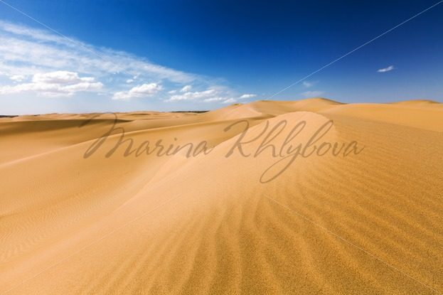 Sand dunes under blue sky. Desert near Senek village, Kazakhstan – Stock photos from around the world