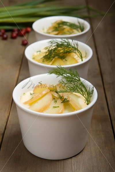 Swedish food: baked salmon with potatoes and milk – Stock photos from around the world